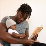 Father and baby reading